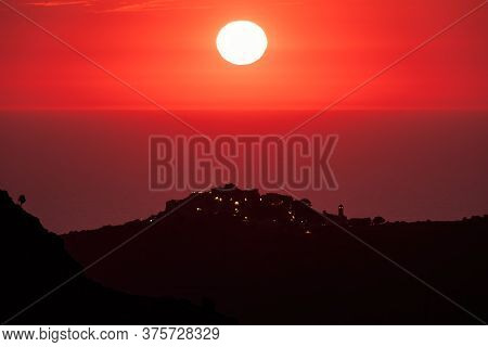 Sun Setting Over The Village Of Sant'antonino And Mediterranean
