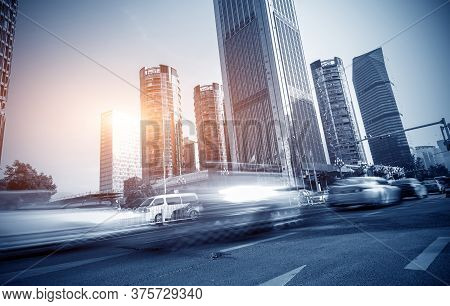 The City's Tall Buildings And High-speed Cars, The Urban Landscape Of Beijing, China.
