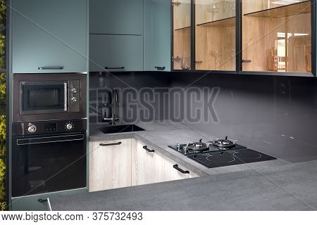 Upscale Aqua Menthe Kitchen In Luxury Home With Hob Induction Electric Microwave Oven Flat Wooden Pa