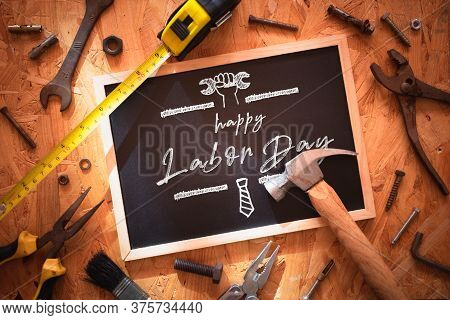 Happy Labor Day Background Concept. Blackboard On Wood With Grunge And Rusty  Engineering Handy Tool