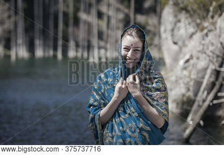 The Girl Of The European Appearance Laugh And Poses In The Indian Sari At Kaindy Lake
