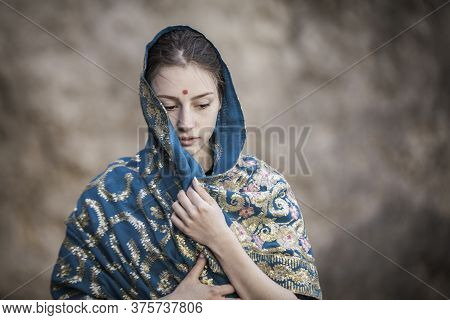 The Girl Of The European Appearance Is Covered With A Sari