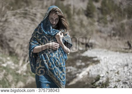 The Girl Of The European Appearance Poses In The Indian Sari At Kaindy Lake