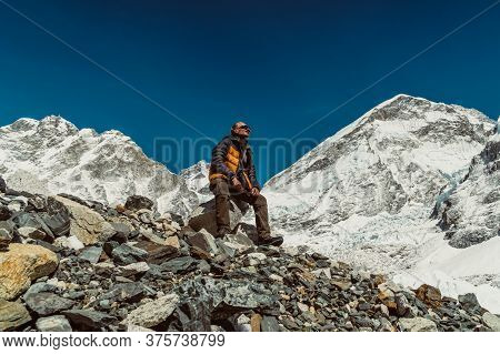 Tourist Admires Beautifull Khumbu Glacier Mountains Landscape At The Everest Base Camp In The Himala