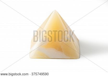 Pyramid Made From Yellow Onyx Possesses Mystical Properties. Souvenir Semiprecious Stone On A White