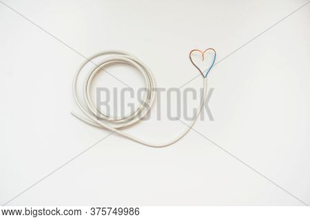 The White Wire In The Form Of Heart, White Background