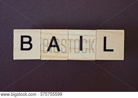 Gray Word Bail Made Of Wooden Square Letters On Brown Background