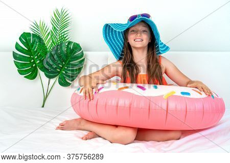 Little Girl Imitates Vacation At Home Quarantine. Domestic Tourism. Coronavirus Situation In Tourism