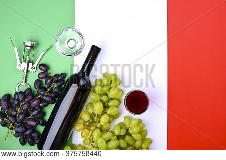 Wine, Grape, Glass Of Wine And Flag Of Italy Close Up. Country Symbol Backdrop. The Concept Of Harve