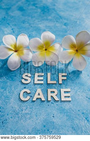 Relaxation And Self-worth Concept, Self Care Text With Blue Background