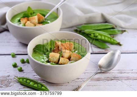 Chilled Soup Puree Of Green Peas,  Seasoned With Green Onion, Mint And Crunchy  Toasted Diced Rusk B