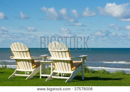 Two Beach Chairs  On An Empty Meadow