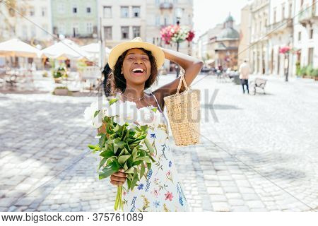 Rear View Of Black Woman Standing On The Square On Sunny Summer Or Spring Day Outside, Cute Smiling