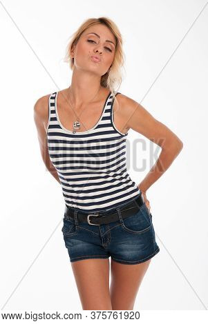 Portrait Of A Beautiful Young Girl In A Striped T-shirt And Jeans Shorts Isolated Over White