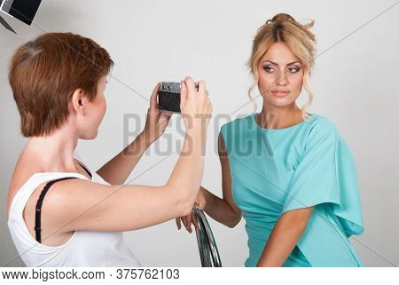 Woman Photographer With Young Beautiful Fashion Woman