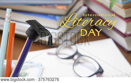 International Literacy Day Concept With A Graduate Hat On Pencil And Book