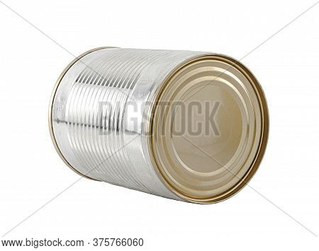 Close-up Of An Iron Tin Can Lying On Its Side. Isolated On A White Background.