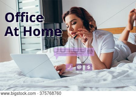 Attractive Teleworker Making Video Call With Headset And Laptop In Bed During Self Isolation With Of