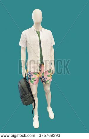 Full Length Male Mannequin Dressed In Short Sleeve Button-down Shirt And Shorts, Isolated On Blue Ba