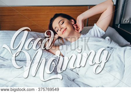 Attractive Positive Girl Chilling In Bed In Morning During Self Isolation With Good Morning Sign
