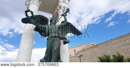 Angel Statue With The Calvi Castle In The Background, Corsica, France