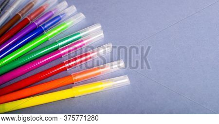 Multicolored Felt-tip Pens Or Markers On Gray Background.