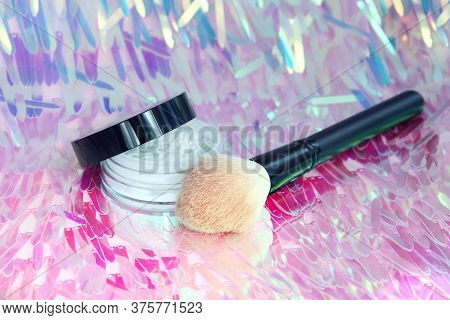 Face Powder And Makeup Brush On Glistening Background. Holographic Sequins.