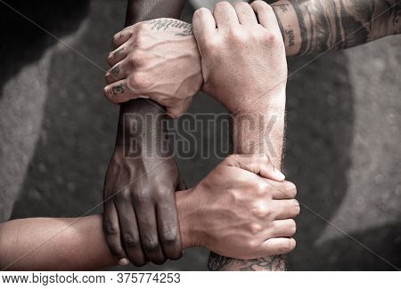 Multiethnic  People With Black, Latin, Caucasian And Asian Hands Holding Each Other Wrist. Tolerance