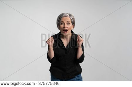 Enthusiastic Mature Woman With Open Mouth Rejoices In Gain. Caucasian Lady Expresses Delight And Joy