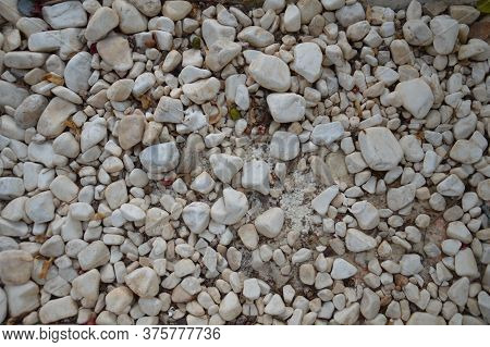 Texture Of The Sea Shore Of Stones And Pebbles In The Aegean