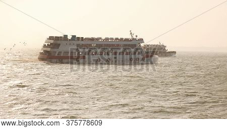 Two Large Running Tourist Ship At Sunset Time In Deep Sea Make A Charming Beauty Of Nature .