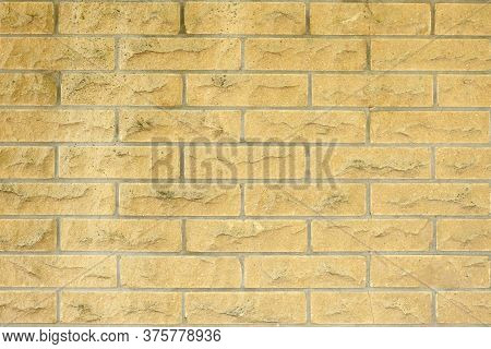 New And Clean Yellow Brick Wall. High Resolution Photo. Full Depth Of Field (dof).