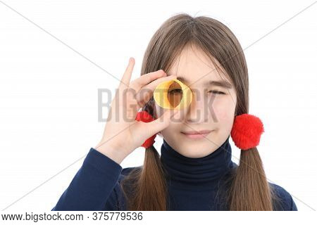 Portrait Of Pre-adolescent Girl Holding Potato Chips Like Sunglaces. Isolated On White Background. H