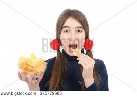 Pre-adolescent Girl Holding Bowl Is Full Of Potato Chips. Isolated On White Background. High Resolut