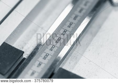 Calipers Fragment With Scale, Blue Toned Close-up Photo With Selective Focus