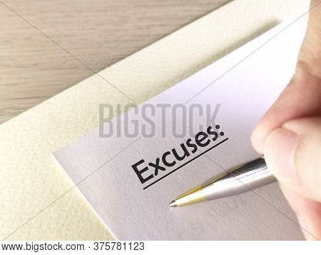 One Person Is Writing On Paper About Excuses.