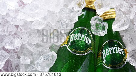 Bottles Of Perrier Mineral Water In Crushed Ice