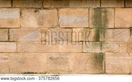 Aged Brickwall. Antique Masonry Or Brickwork From Different Sizes Of Brick Blocks. Retro Brick Textu