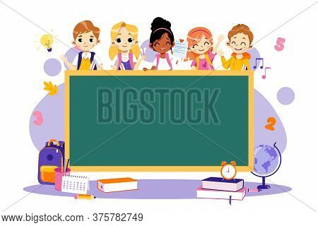 Back To School Concept. Multi Ethnic Group Of Students Around The Blackboard. Classroom With Chalkbo