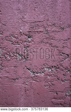 Cracked Concrete Wall Painted With Burgundy Paint. Peeled Burgundy Paint On A Concrete Wall. Cracked