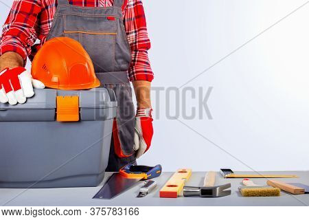 Builder Handyman With Construction Tools. Labor Day Concept With Copy Space.