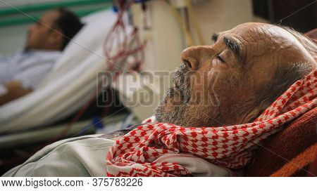 Aleppo, Syria 25 May 2020:\na Doctor Measures The Pressure Of A Sick Old Man