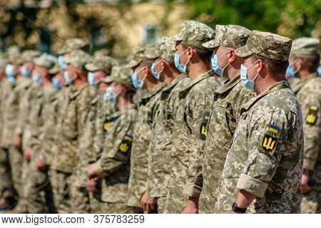 Uzhgorod, Western Ukraine - July 10, 2020: Ukrainian Army Soldiers Wearing Face Masks As Preventive