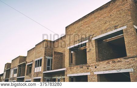 Brick Townhouses under construction in the evening