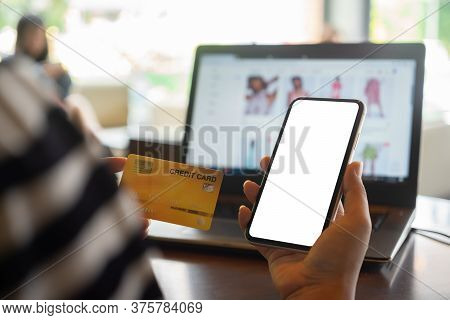 Mockup Blank White Screen Mobile Phone For Online Shopping In Internet Concept. Woman Using Credit C
