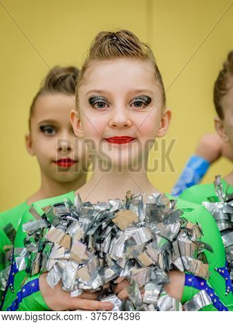 Moscow, Russia - December 22, 2019: Close-up Portrait European Appearance Fair-haired Young Girl Of