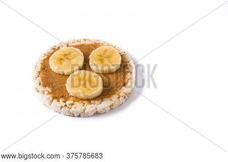 Puffed Rice Cake With Banana And Peanut Butter Isolated On White Background. Copy Space