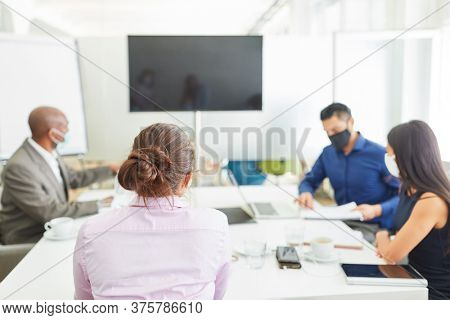 Business people with face mask because of Covid-19 in a meeting or meeting