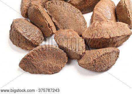 Brazilian Nut In Peel. Bertholletia On Isolated White Background.