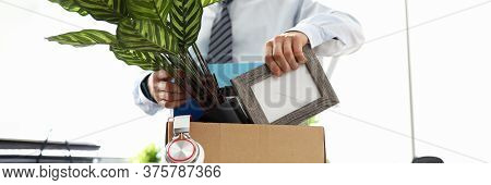Man Business Clothes Puts Things Into Box At Office. Manipulative Methods Influencing People For Pur